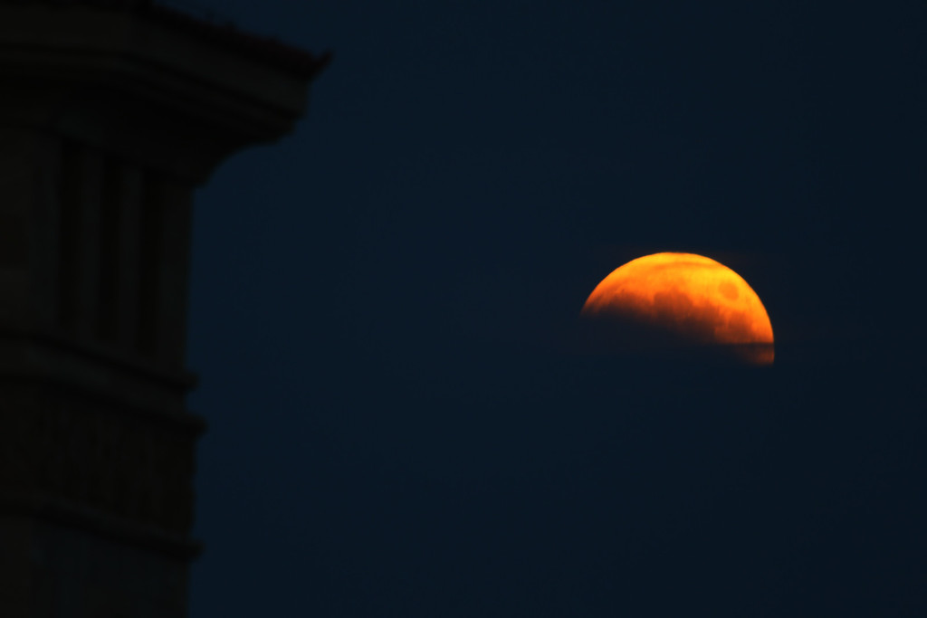 . Total eclipse of the moon is seen on October 08, 2014 in Qingdao, Shandong province of China. The moon turns red and half-shadowed during total lunar eclipse in Qingdao on Wednesday.  (Photo by ChinaFotoPress/ChinaFotoPress via Getty Images)
