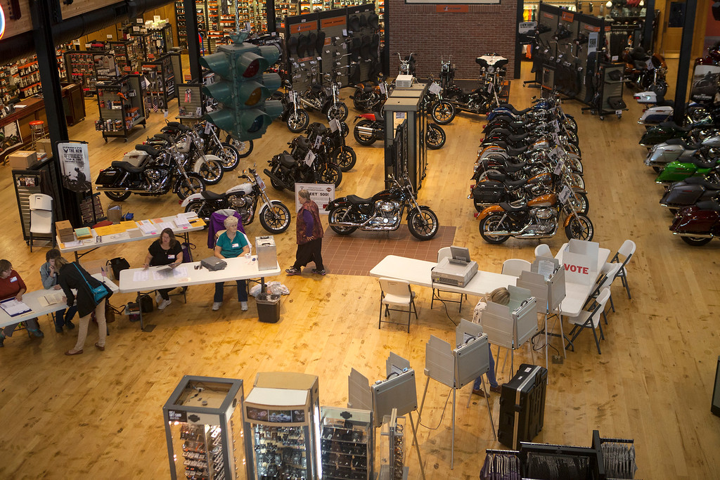 """. Voters cast their ballots at the Frontier-Harley Davidson store on West \""""O\"""" Street in Lincoln, Neb. Election Day, Tuesday, Nov. 4, 2014. (AP Photo/The Journal-Star, Matt Masin)"""