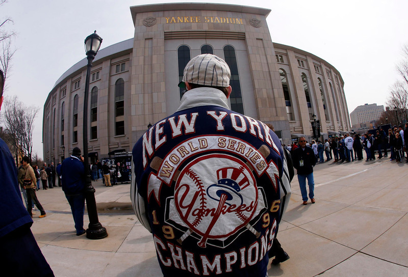 . A New York Yankees fan waits for the gates to open outside Yankee Stadium before the Yankees\' opening day MLB American League baseball game against the Boston Red Sox in New York, April 1, 2013.  REUTERS/Mike Segar