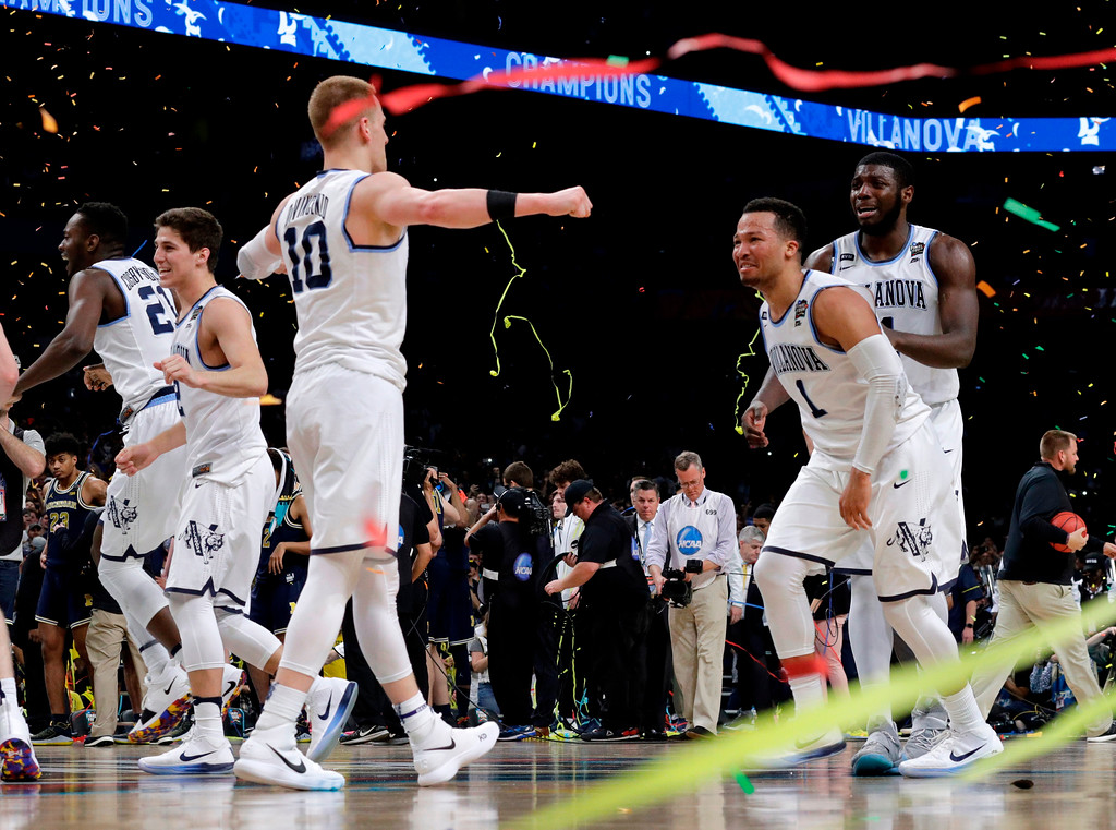 . Villanova guard Jalen Brunson (1) celebrates with teammate Donte DiVincenzo, left, after the championship game against Michigan in the Final Four NCAA college basketball tournament, Monday, April 2, 2018, in San Antonio. Villanova won 79-62. (AP Photo/David J. Phillip)