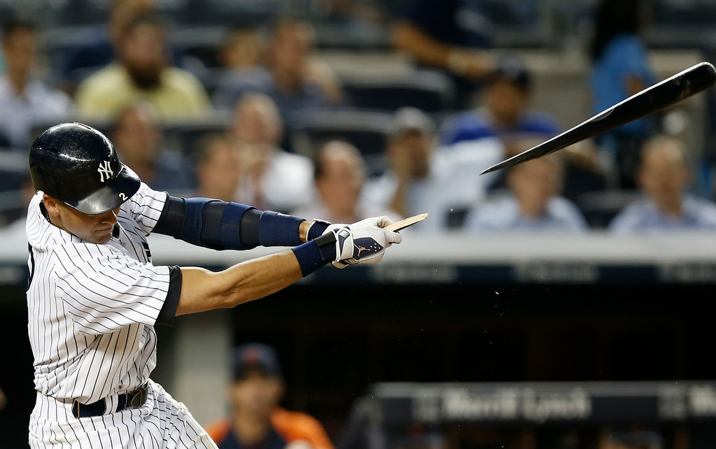 . New York Yankees Derek Jeter breaks his bat on a fourth-inning flyout in a baseball game against the Detroit Tigers at Yankee Stadium in New York, Wednesday, Aug. 6, 2014.  (AP Photo/Kathy Willens)