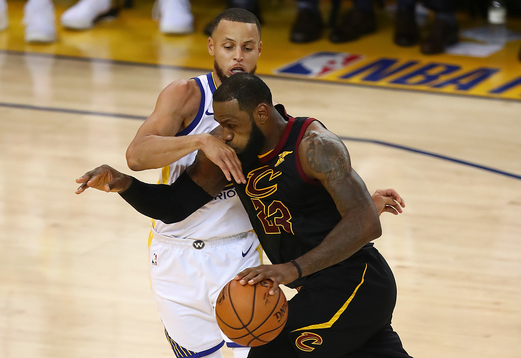 . Cleveland Cavaliers forward LeBron James (23) drives against Golden State Warriors guard Stephen Curry during the second half of Game 1 of basketball\'s NBA Finals in Oakland, Calif., Thursday, May 31, 2018. (AP Photo/Ben Margot)
