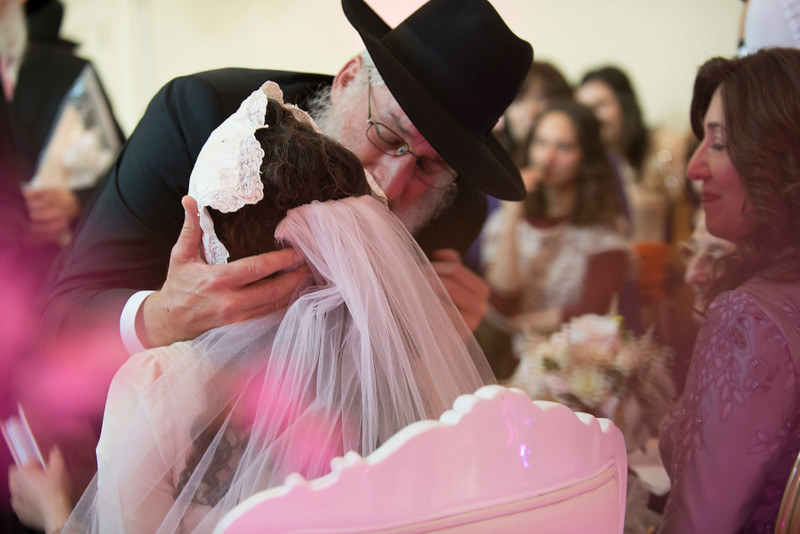 Elozor Plotke is kissing his daughter after blessing her before the chuppa at her wedding. He told me he burst into tears and never expected to cry as we see here.