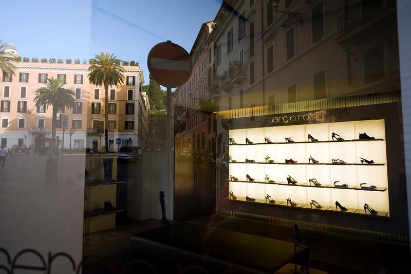Piazza di Spagna reflections on Sergio Rossi shop window, Rome