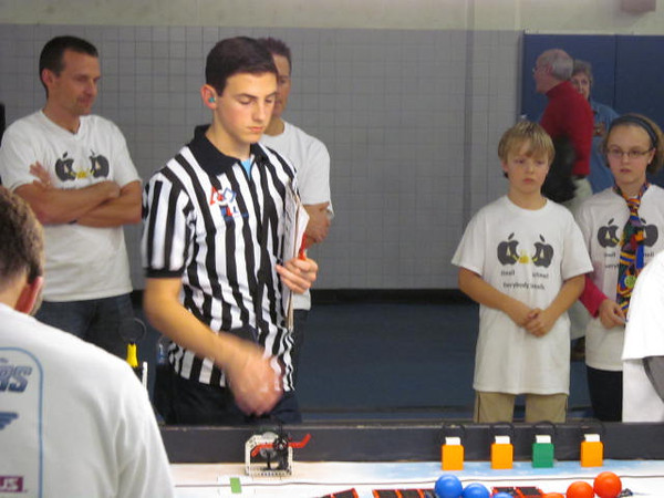 Curtis clicks the timer back one notch after a team handles their robot out of base.