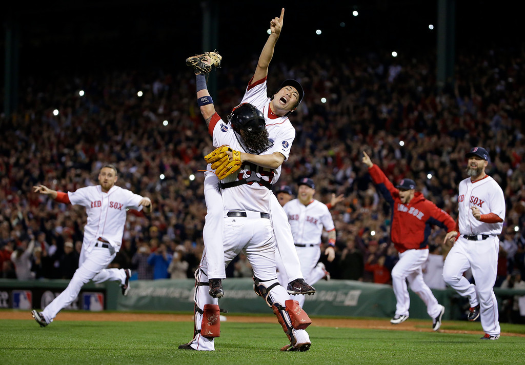 . Boston Red Sox relief pitcher Koji Uehara, rear, and catcher Jarrod Saltalamacchia celebrate the Red Sox 5-2 win over the Detroit Tigers in Game 6 of the American League baseball championship series on Saturday, Oct. 19, 2013, in Boston. The Red Sox advance to the World Series. (AP Photo/Matt Slocum)
