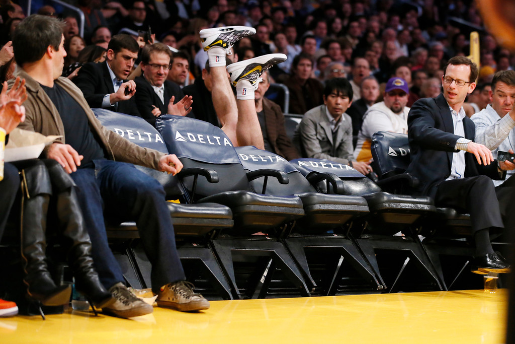 . Los Angeles Lakers\' Steve Blake falls over empty courtside chairs as he tries to save a ball from going out of bounds against the Phoenix Suns during the first half of an NBA basketball game on Tuesday, Feb. 12, 2013, in Los Angeles. (AP Photo/Danny Moloshok, File)
