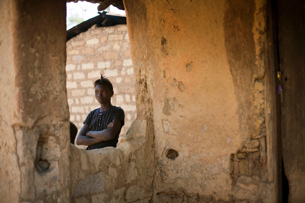 . In this photo taken Thursday Nov. 20, 2014, an unidentified woman stands in the Guinean village of Meliandou, some 400 miles (600 mms) south-east of Conakry, Guinea, believed to be Ebola\'s ground zero.  (AP Photo/Jerome Delay)