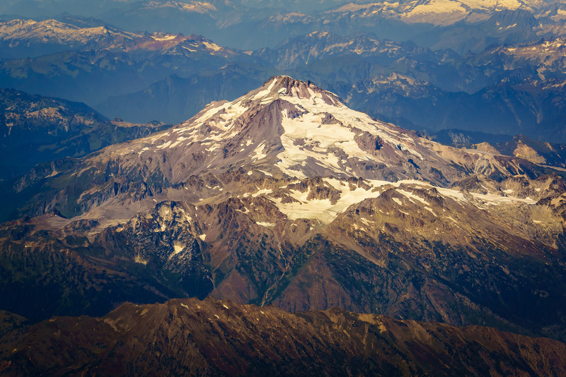 As soon as someone can tell me which Cascade Mountain this is, this one will get a title.  All I know is that it is in Washington State and was on the north side of the plane as we approached Sea-Tac.