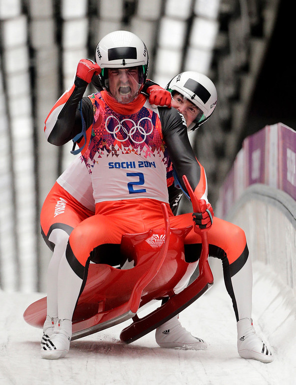 . The doubles team of Andreas Linger and Wolfgang Linger from Austria celebrate in the finish area after their final run to win the silver medal during the men\'s doubles luge at the 2014 Winter Olympics, Wednesday, Feb. 12, 2014, in Krasnaya Polyana, Russia.  (AP Photo/Jae C. Hong)