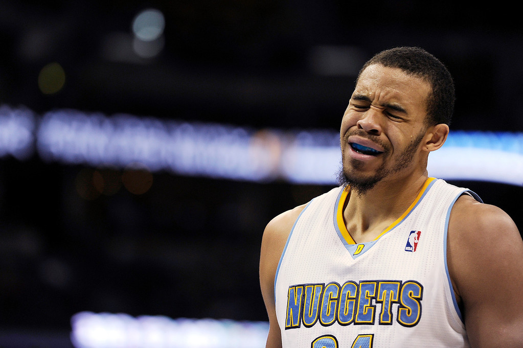 . JaVale McGee #34 of the Denver Nuggets reacts after fouling during the second quarter of an NBA game against the San Antonio Spurs at the Pepsi Center on November 5, 2013, in Denver, Colorado. (Photo by Daniel Petty/The Denver Post)