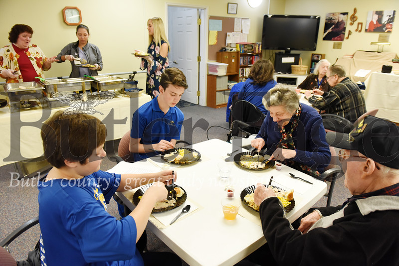 Harold Aughton/Butler Eagle: Eigth graders from St. Gregory's spent time witht the resident of Newhaven Court, Tues., Nov. 19, 2019.
