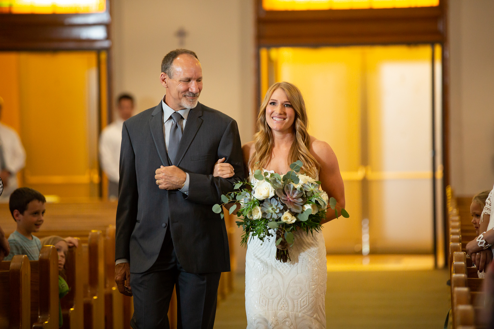 Father proudly walks his daughter down the aisle