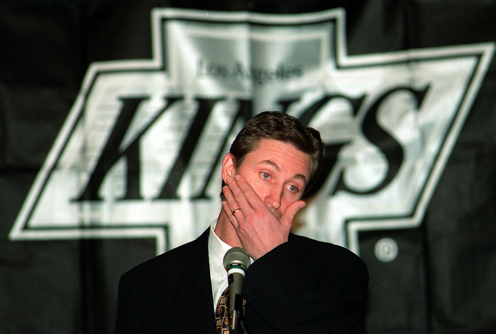 ". Wayne Gretzky reacts during a news conference in Los Angeles, Tuesday, Feb. 27, 1996, where he announced that he has been traded to the St. Louis Blues. Gretzky said, ""I am emotionally drained.\"" Gretzky, the hockey great who failed to win a Stanley Cup in Los Angeles, was traded to the St. Louis Blues on Tuesday Feb. 27, ending weeks of rumors and speculation about his future.  (AP Photo/Kevork Djansezian)"