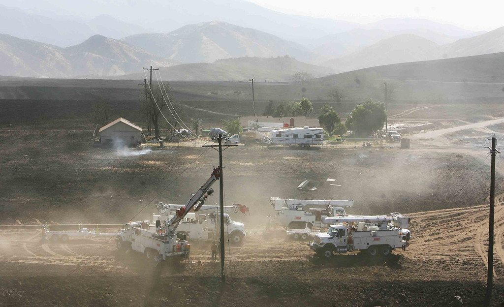 . Edison crews work to replace power poles damaged by the Summit Fire in the hills above Banning, Ca.,  Thursday morning May 2, 2013.   (AP Photo/The Press-Enterprise,Kurt Miller )