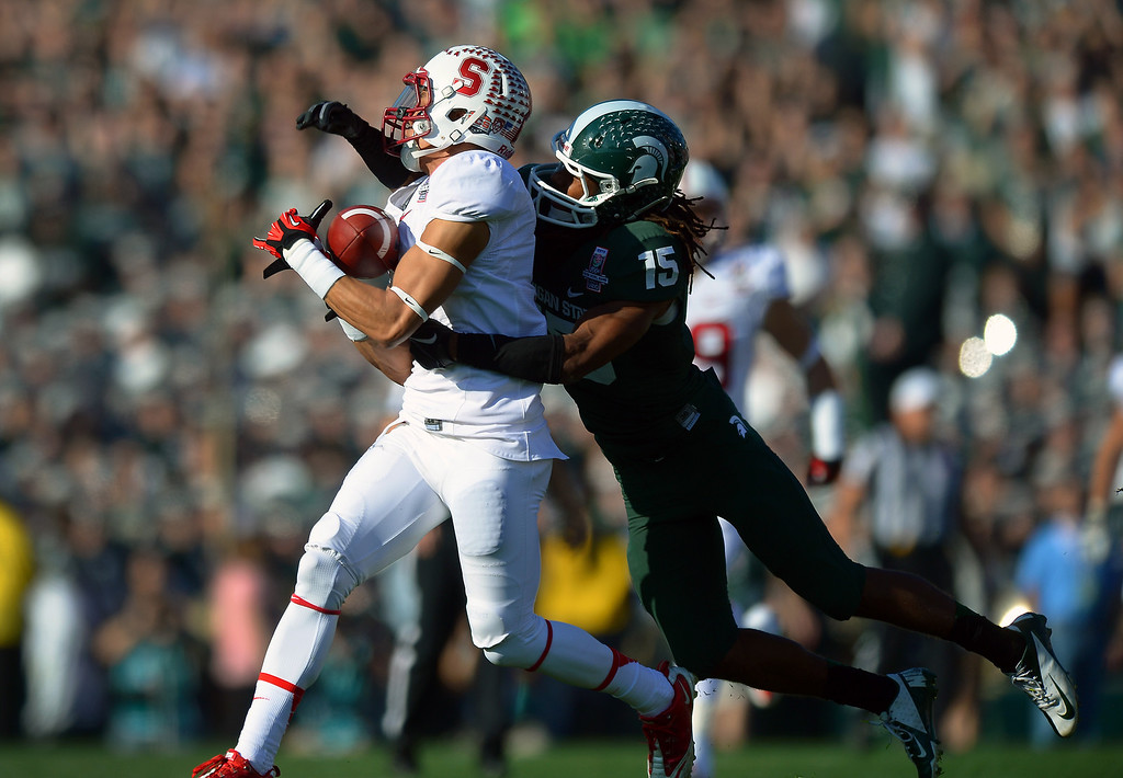 . Stanford WR Michael Rector hauls in a 42-yard pass play behind Michigan State\'s Trae Waynes in the first quarter at the Rose Bowl, Wednesday, January 1, 2014. (Photo by Michael Owen Baker/L.A. Daily News)