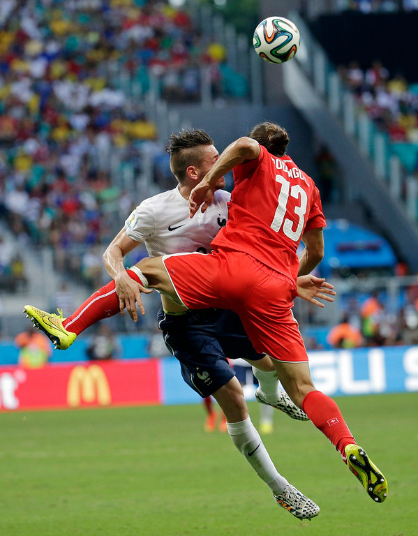 . France\'s Mathieu Debuchy collides with Switzerland\'s Ricardo Rodriguez as they go up for a header during the group E World Cup soccer match between Switzerland and France at the Arena Fonte Nova in Salvador, Brazil, Friday, June 20, 2014. (AP Photo/Bernat Armangue)