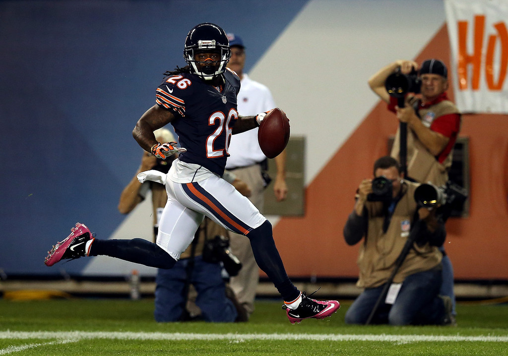 . Cornerback Tim Jennings #26 of the Chicago Bears intercepts a pass for a touchdown against the New York Giants during a game at Soldier Field on October 10, 2013 in Chicago, Illinois.  (Photo by Jonathan Daniel/Getty Images)