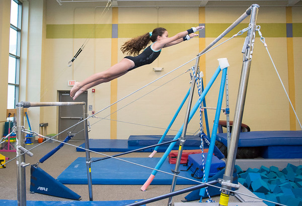 08/22/19 Wesley Bunnell | Staff The New Britain YWCA held an open house on Thursday August 22, 2019 to showcase the programs and benefits for prospective members. Gymnastics team member Thaina Rosado, age 10, leaps between the uneven bars.