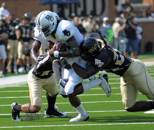 J Jones and B Ghee tackle Griffin.jpg