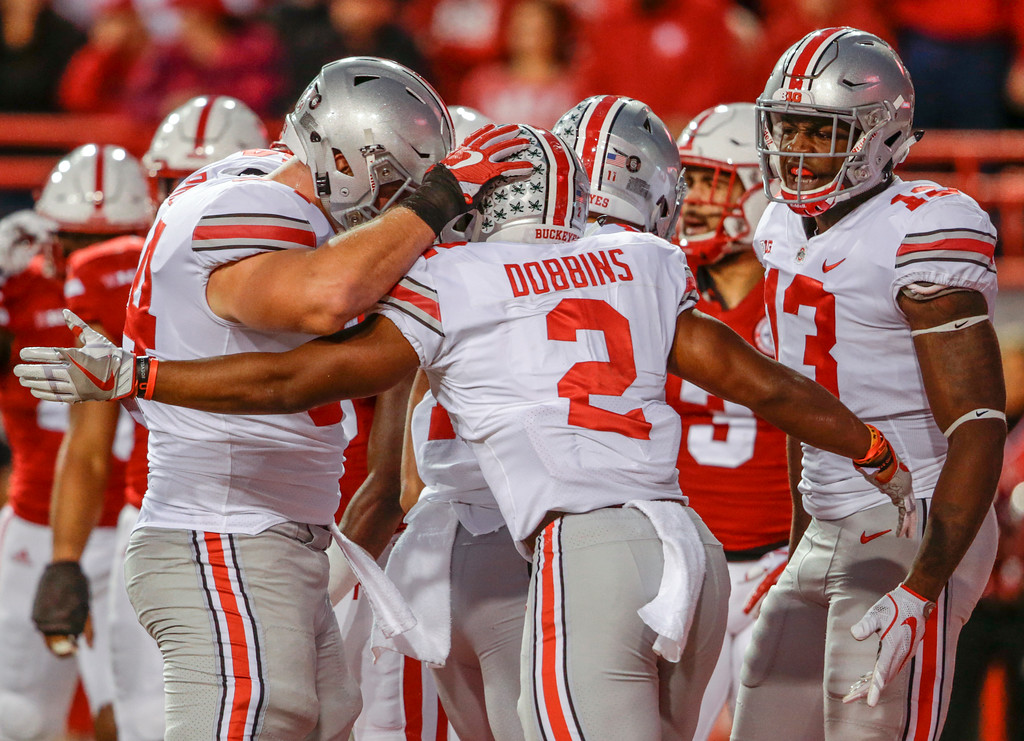. Ohio State running back J.K. Dobbins (2) celebrates his touchdown against Nebraska with teammates during the first half of an NCAA college football game in Lincoln, Neb., Saturday, Oct. 14, 2017. (AP Photo/Nati Harnik)