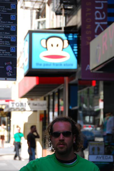 John under a monkey.  We were waiting for a bus.