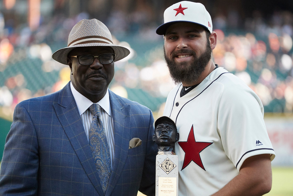 ". Detroit Tigers starting pitcher Michael Fulmer, right, receives the ""Larry Doby Legacy Award for American League Rookie of the Year\"" award from Bob Kendrick, president of the Negro Leagues Baseball Museum, prior to the second baseball game of a doubleheader against the Cleveland Indians in Detroit, Saturday, July 1, 2017. (AP Photo/Rick Osentoski)"