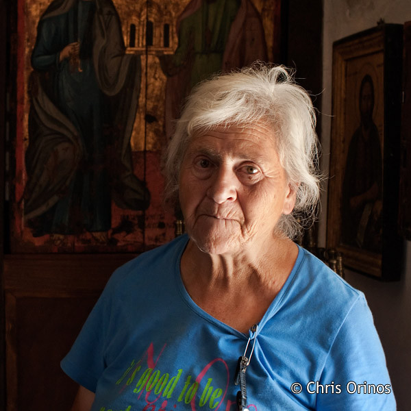 "An old lady helping with the ""housekeeping"" of a church in Crete. In Greek ""νεωκόρισσα"" or ""καντηλανάφτισσα""."