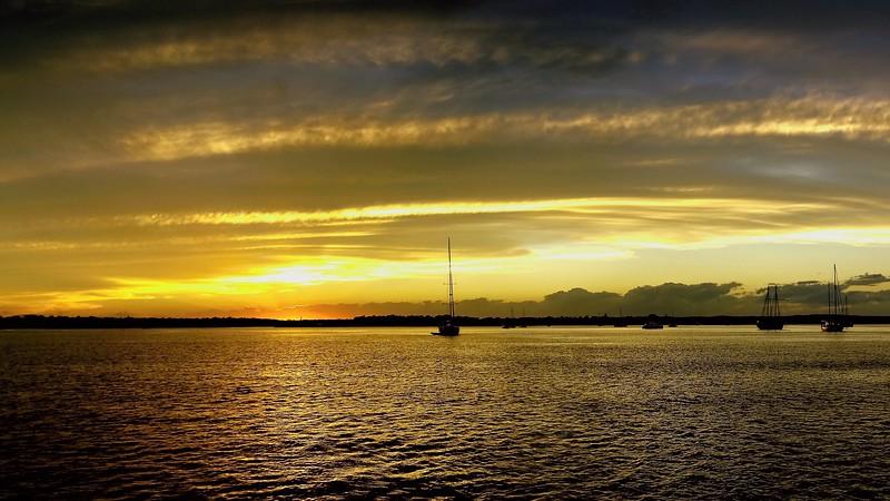 Gold coloured Cirrostratus cloudy coastal Sunset Seascape. Queensland, Australia