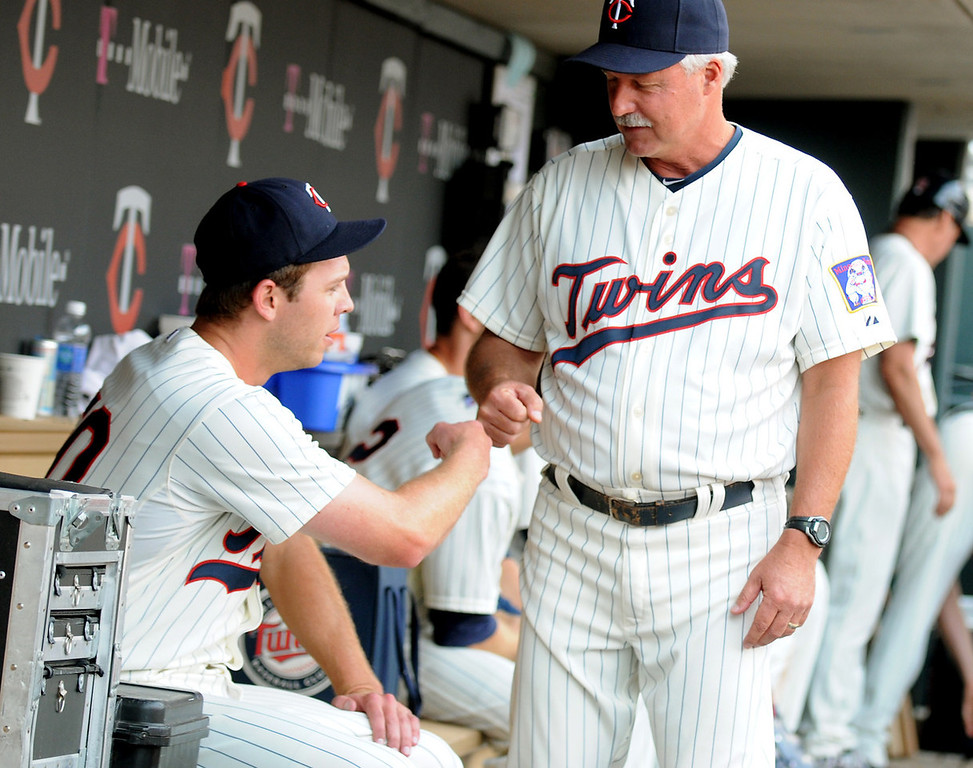 . Minnesota relief pitcher Casey Fien gets a fist bump from pitching coach Rick Anderson after working out of a jam by striking out two Royals in a row with the bases loaded to end the eighth inning. (Pioneer Press: John Autey)