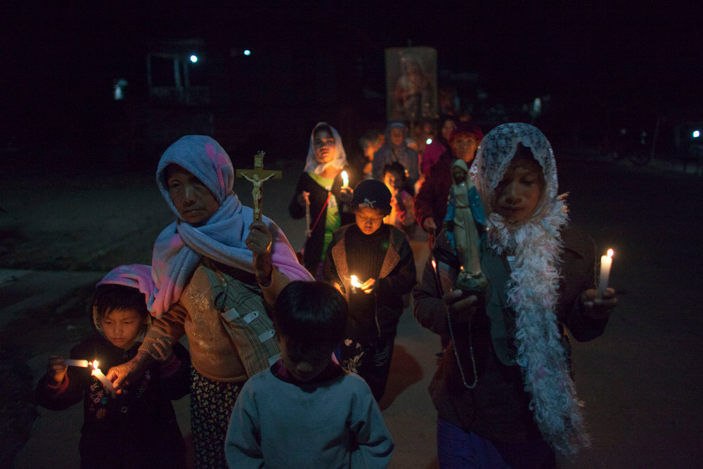 . Catholic believers hold candles while they march and chant prayers for peace in the town of Laiza, in northern Myanmar\'s Kachin-controlled region, Monday, Jan. 28, 2013. A key outpost protecting the headquarters of ethnic Kachin rebels in northern Myanmar has fallen to government troops, a spokesman for the guerrilla group said Sunday. The Kachin Independence Army spokesman said the hillside outpost at Hka Ya Bhum, near the guerrilla group\'s headquarters in the town of Laiza, was overrun Saturday afternoon. (AP Photo/Alexander F. Yuan)