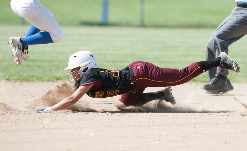 05/30/18  Wesley Bunnell   Staff  Southington softball defeated New Britain 19-1 in a second round Class LL tournament game at Southington on Wednesday afternoon. Nana Andujar (12) slides safely head first into second base