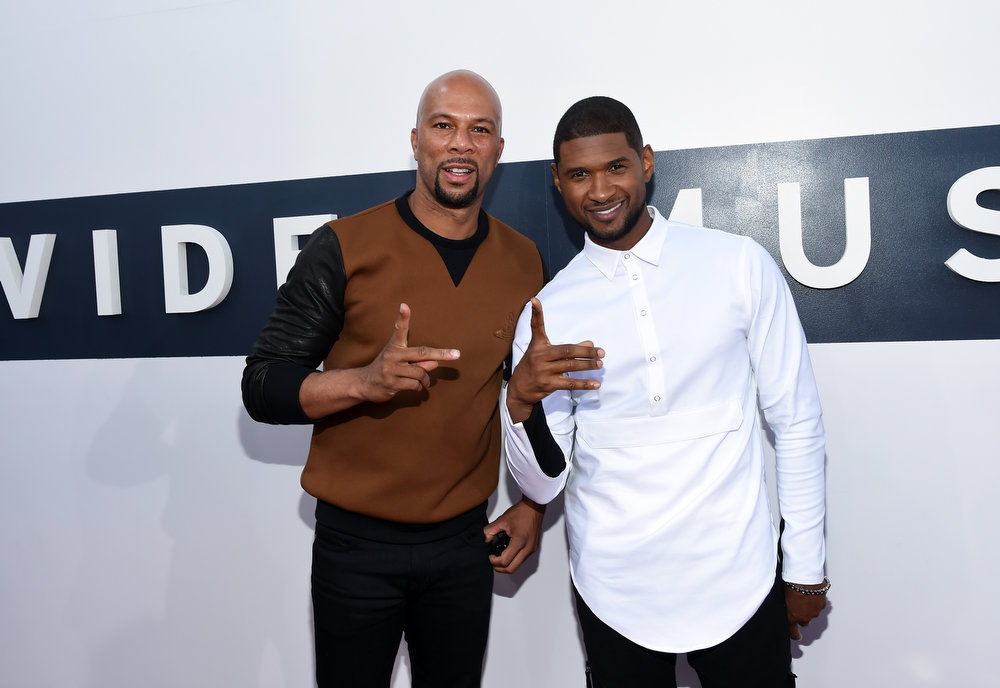 . Rapper/actor Common (L) and singer Usher attend the 2014 MTV Video Music Awards at The Forum on August 24, 2014 in Inglewood, California.  (Photo by Larry Busacca/Getty Images for MTV)