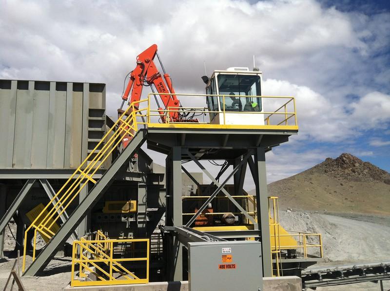 NPK B500 pedestal boom with GH4 hydraulic hammer on platform-rock breaking in quarry.jpg