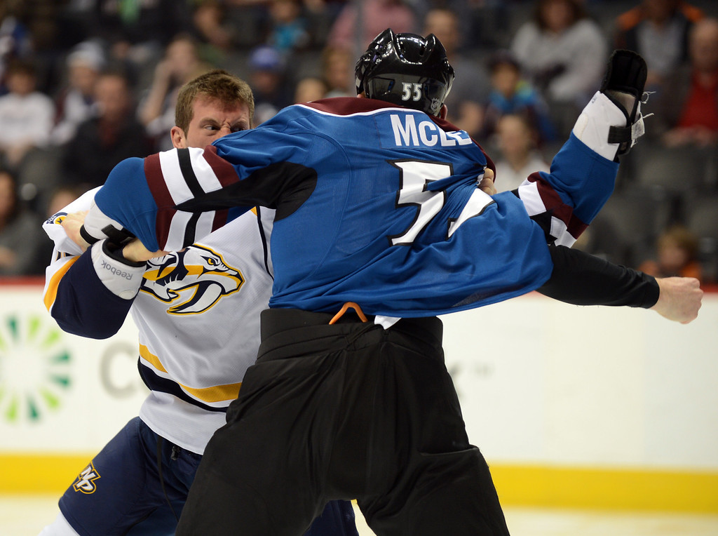. Cody McLeod of Colorado Avalanche (#55) and Rich Clune of Nashville Predators (#16) are fighting in the 1st period of the game at Pepsi Center. Denver, Colorado. March 30, 2013. (Photo By Hyoung Chang/The Denver Post)