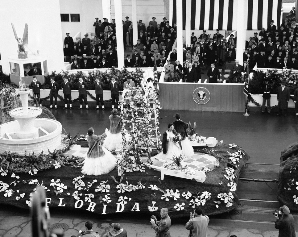 . President Dwight Eisenhower and other members of his reviewing stand box show their appreciation as the Florida float passes in the inaugural parade in Washington  Jan. 21, 1957. The Florida girls riding the float apparently found the chill in the air too much for them � so they wore fur coats. (AP Photo)
