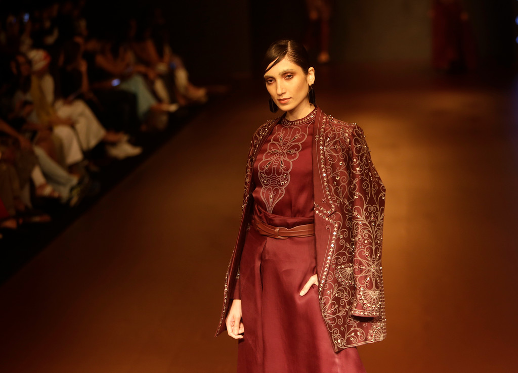 . A model walks the ramp to showcase the creation of  Ankur and Priyanka Modi during the Lakme fashion week winter in Mumbai, India, Wednesday, Aug. 22, 2018. (AP Photo/Rajanish Kakade)