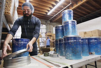 "Kukuruza owner Grant Jones is pictured amongst bins of some of the varieties of his company's gourmet popcorn, as seen on the production floor in the ""Little Saigon"" neighborhood of the International District in Seattle, Wash."