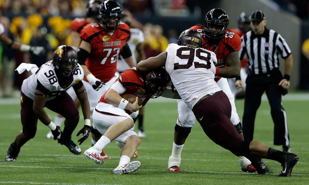 Description of . Seth Doege #7 of Texas Tech is sacked by Ra'Shede Hageman #99 of Minnesota during the Meineke Car Care of Texas Bowl at Reliant Stadium on December 28, 2012 in Houston, Texas.  (Photo by Scott Halleran/Getty Images)
