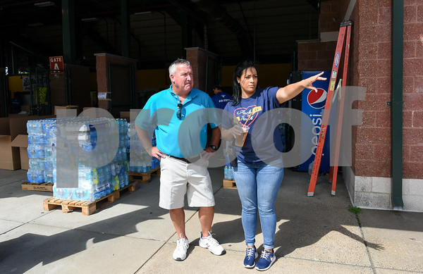 09/08/17 Wesley Bunnell | Staff A Pack the Truck event for Hurricane Harvey relief took place on Friday afternoon in the parking lot at New Britain Stadium. The event was a partnership between the New Britain Bees, Houston Astros outfielder George Springer, Siracusa Moving and Storage, A1 Automotive Repair, the Connecticut Blue Jays AAU Travel Team and Premier Limousine with trucks from Siracusa leaving for Houston following the event. Siracusa owner Dan Siracusa, L, coordinates the event with Nicole Springer from the New Britain Bees and younger sister of George Springer.