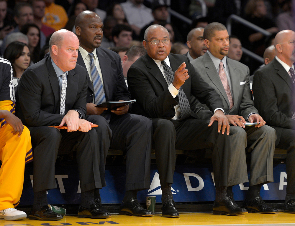 . Los Angeles Lakers interim head coach Bernie Bickerstaff, second from right, looks on along with assistant coaches Steve Clifford, left, Chuck Person, second from left, and Eddie Jordan, right, during the first half of their NBA basketball game against the Golden State Warriors, Friday, Nov. 9, 2012, in Los Angeles. (AP Photo/Mark J. Terrill)