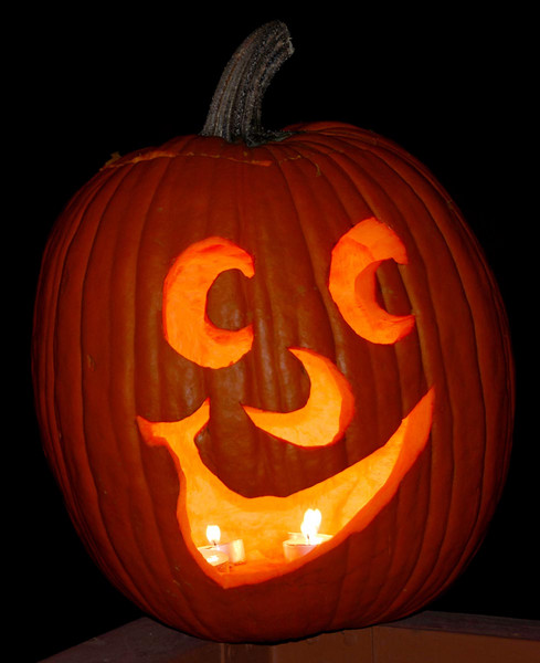 10/30/07 – Jessica had her uncarved pumpkin smashed earlier in the week. We replaced it with this one and she carved it tonight, the day before Halloween.