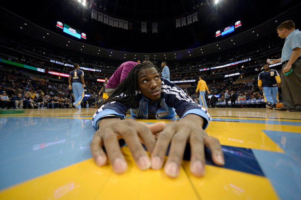 . Denver Nuggets power forward Kenneth Faried (35) stretches during pre game before tip off with the Chicago Bulls November 21, 2013 at Pepsi Center. (Photo by John Leyba/The Denver Post)
