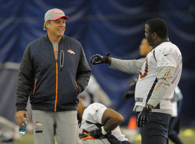 . Denver Broncos defensive coordinator Jack Del Rio smiles as he talks with Denver Broncos defensive end Malik Jackson (70)  during practice under the bubble Wednesday, December 19, 2012 at Dove Valley as they prepare for the Cleveland Browns.  John Leyba, The Denver Post