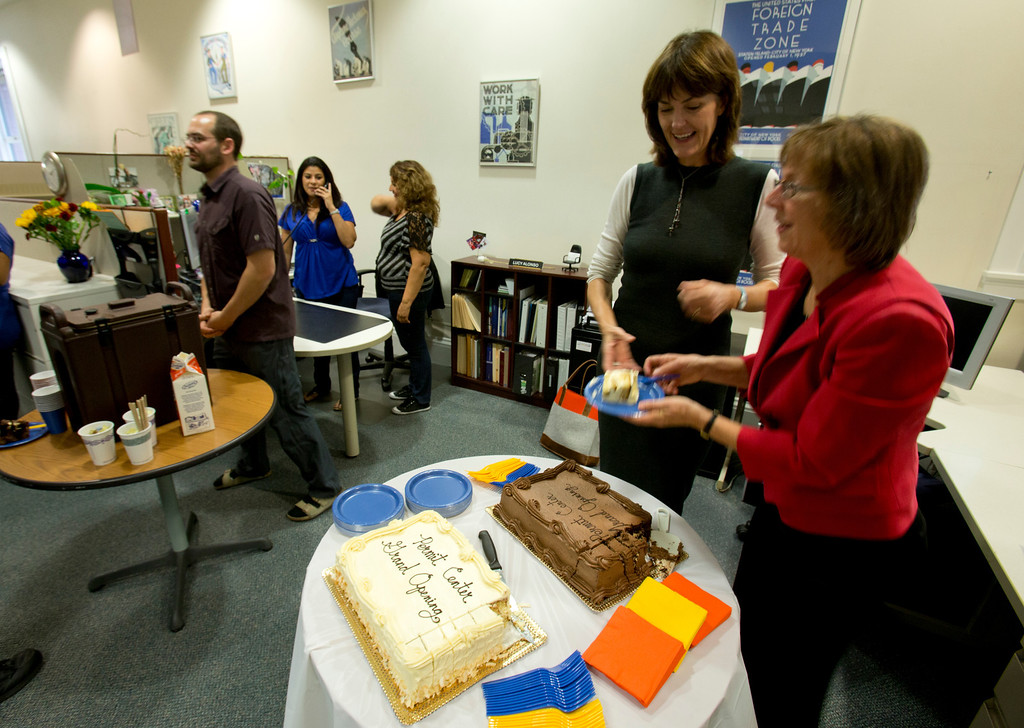 . Community Development Director Debbie Potter, right, cuts a piece of cake for Stacey McCarthy, general manager of PM Realty Group, at the dedication ceremony for the newly remodeled Permit Center inside City Hall, Wednesday, Nov. 6, 2013 in Alameda, Calif. (D. Ross Cameron/Bay Area News Group)