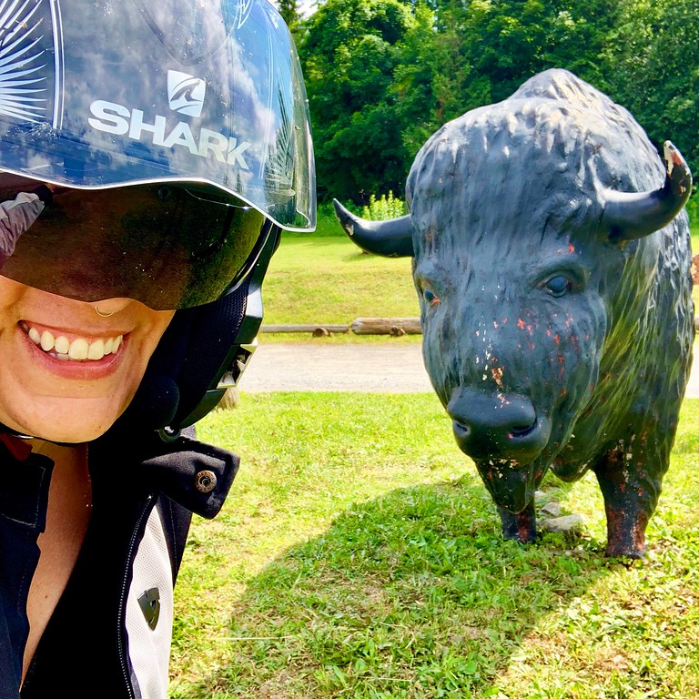 fuzzygalore girlie motorcycle blogger at the tepee cherry valley new york with buffalo statue
