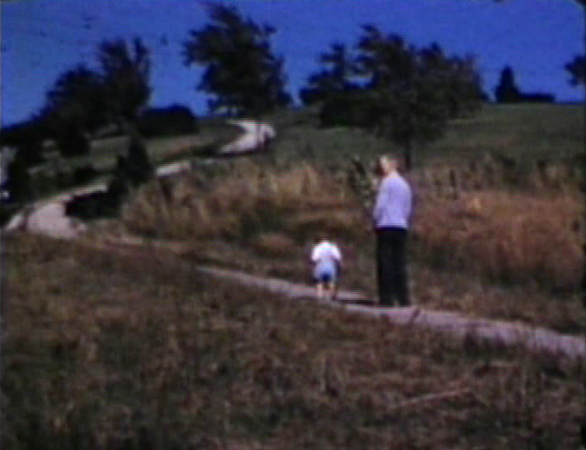 1947 3630 Jennings Street, Sioux City, IA Morrie and Miles walk by empty lot where our home would be built in 1950.