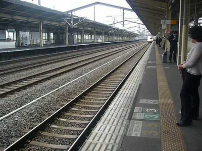 Japan, Shinkansen arriving at train station nr Tokyo