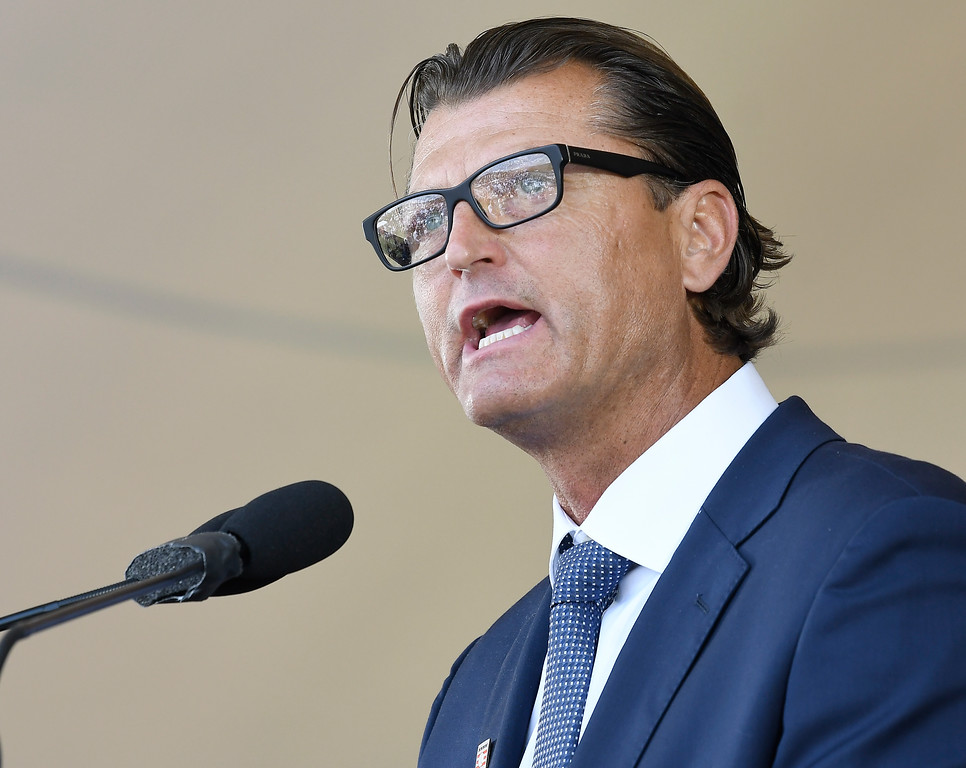 . National Baseball Hall of Fame inductee Trevor Hoffman speaks during an induction ceremony at the Clark Sports Center on Sunday, July 29, 2018, in Cooperstown, N.Y. (AP Photo/Hans Pennink)