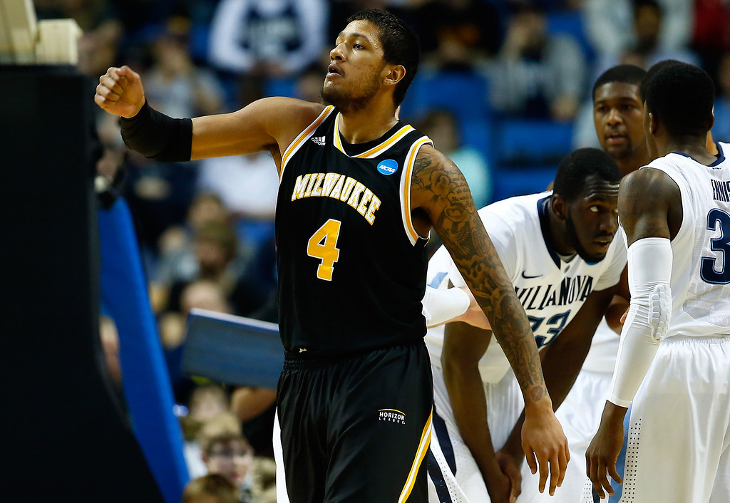 . BUFFALO, NY - MARCH 20: Malcolm Moore #4 of the Milwaukee Panthers reacts against the Villanova Wildcats during the second round of the 2014 NCAA Men\'s Basketball Tournament at the First Niagara Center on March 20, 2014 in Buffalo, New York.  (Photo by Jared Wickerham/Getty Images)